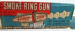 VINTAGE NU AGE SMOKE RING SPACE GUN IN BOX with 2 PACKS OF SMOKE PELLETS & STRIKE