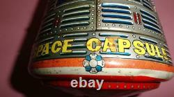 VTG NASA SPACE CAPSULE ROCKET USA w ASTRONAUT BATT. OP by S. H JAPAN TIN TOY 1960s