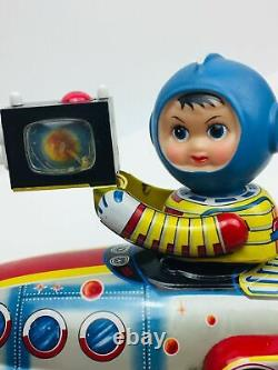Vintage Tin Litho Space Toy Rocket Ship Boy Pilot Holding Video Movie Camera